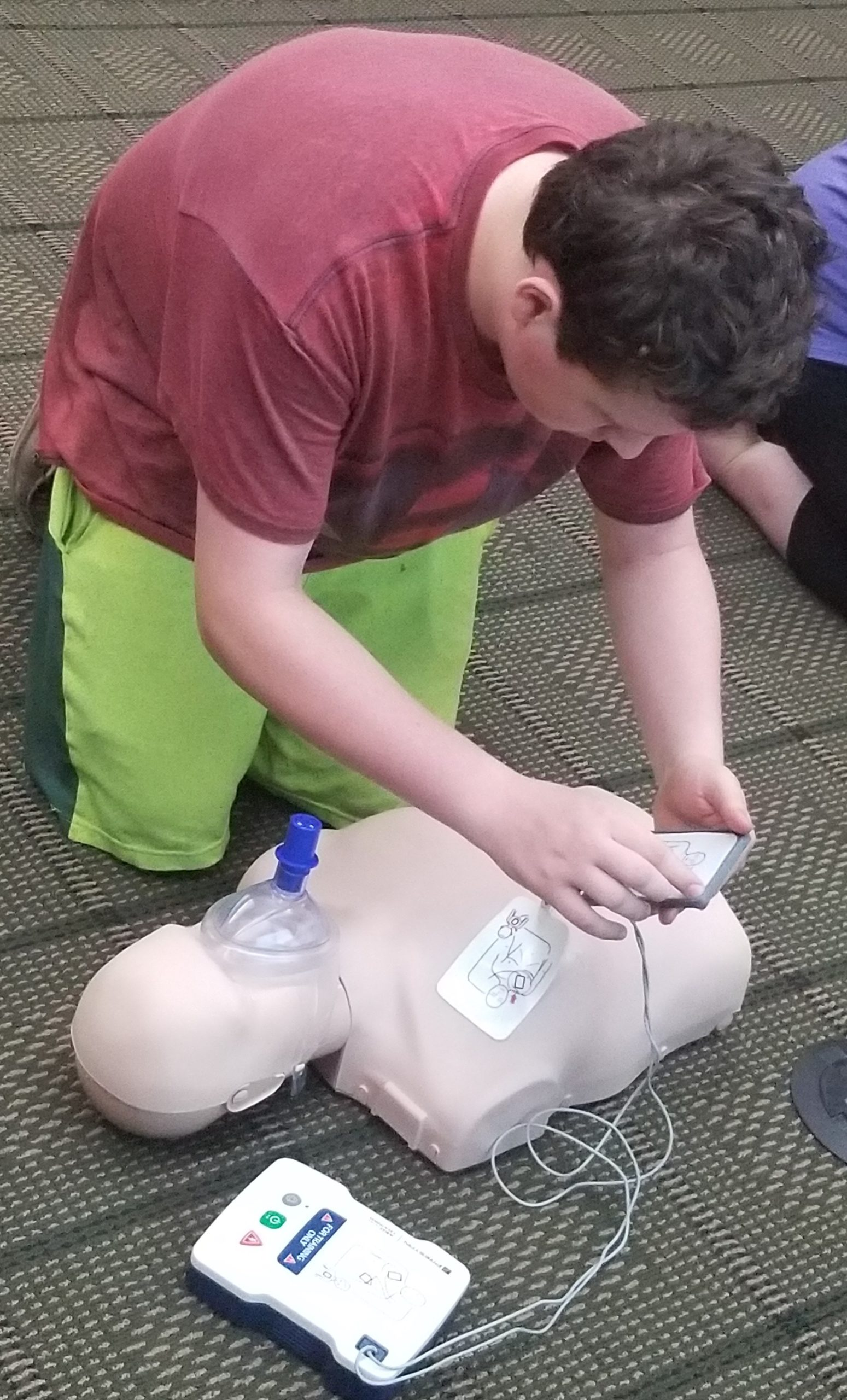 Student practicing AED usage